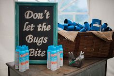 Bug spray is essential for an outdoor wedding. Draw attention to the spray bottles with a large sign.