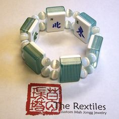 Refreshing turquoise-striped Mah Jongg tiles and 10mm white fiber optic beads. Its made with NEWS Wind tiles and the blue and white Dragons. This fits
