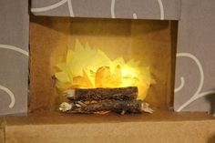 Use sticks and tissue paper to make a fire for the fireplace.