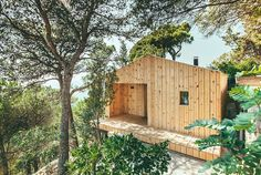 as well as being a prefabricated building, the wood studio utilizes a number of sustainable methods to enhance the living space and at the same time, minimize the effect on the landscape.