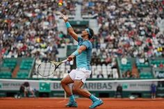 Spain's Rafael Nadal serves to Sam Groth of Australia during the first round of the French Open at Roland Garros Tennis Photography, Amazing Photography, Refugee Crisis, French Open, Rafael Nadal, Tennis Racket, How To Memorize Things, Spain, Photographs