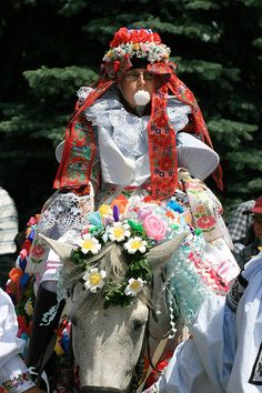 The Moravian/Slovacko Jizda Kralu (Ride of the Kings) Folk Festival which takes place in May at Vlcnov, Czech Republic. The King is a juvenile boy in woman's folk costume, with a rose held firm by his lips.