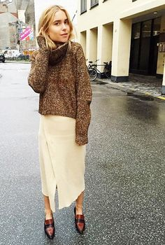 Throw on a chunky turtleneck sweater over a wrap skirt to copy Look De Pernille's street style look.