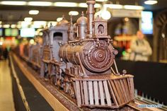 World's longest chocolate train displayed in Brussels  A train made entirely of chocolate set a new Guinness World Record on Monday as the longest chocolate structure in the world. The sculpture, on display at the busy Brussels South station, is just over 34 meters long and weighs over 1,250 kilos.  Maltese chocolate artist Andrew Farrugia spent over 700 hours constructing the chocolate train. He said he came up with the idea last year after visiting the Belgian Chocolate Festival in Bruges