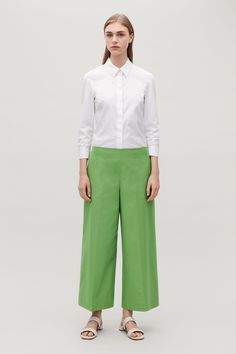 Model front image of Cos cropped trousers with pressfolds in green Cos Trousers, Cropped Trousers, Trousers Women, Pants, Small Wardrobe, Vintage Style Dresses, White Shirts, Things To Buy, New Product