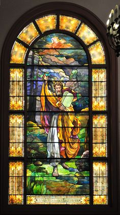 """This stained glass window depicting Moses with the Tablets, now on the western side of the Schoenfeld-Gardner Chapel of Temple De Hirsch Sinai, Seattle, was salvaged from the 1908 Temple De Hirsch, where it was located on the east end, over the Ark and Torah. The text at the bottom says """"In memory of Fred Schwabacher the gift of his mother""""."""