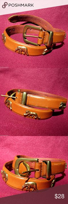 """African Safari Brass & Leather Belt Waist Cincher Lovely brown Italian leather African Safari belt depicting some of the wild fauna one would encounter on the Serengeti, including an elephant, leopard and rhinoceros in brass accents. The back is stamped """"Genuine Italian Leather"""" and near the buckle it's stamped China. The length from the buckle to the other end is 25"""", which is perfect as a waist-cincher or upper waist accent.  Good quality condition; there are some light scratches on the…"""