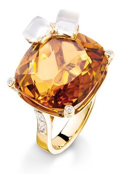 Piaget Limelight Whiskey on the Rocks cocktail inspiration ring with a cushion-cut citrine, two quartz and 100 brilliant-cut diamonds set in 18-karat gold.