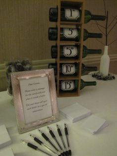 Wine bottles filled with anniversary wishes from the wedding guests