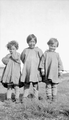 Two Métis children with an Inuit child at the All Saints Residential School, in Shingle Point, Yukon, in 1930. Residential Schools: A Photo History