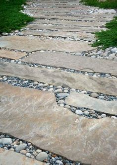 Long cut flagstone set in riverstone