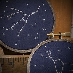 constellation embroidery -- amazing.  Now where do I get navy blue embroidery fabric? and love the hoops.