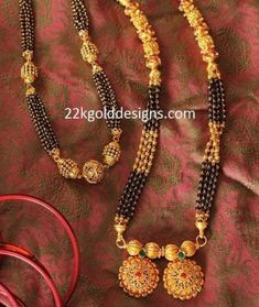 22 carat gold designer black beads long chain which has nakshi balls and gold mangalsutra pendant with rubies and emeralds. Gold Mangalsutra Designs, Gold Earrings Designs, Gold Jewellery Design, Necklace Designs, Mangalsutra Simple, Ring Designs, Gold Jewelry Simple, Golden Jewelry, Silver Jewelry