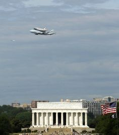 The Space Shuttle Discovery, mounted on the Shuttle Carrier Aircraft, flies over the Lincoln Memorial in Washington, Tuesday, April 17, 2012.