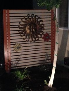 This not only covers the hvac unit, you can decorate it like you see here by adding any decorative wall hanging like this example, adds a personal touch. Hvac Installation, Decoration For Ganpati, Diy Home Decor On A Budget, Backyard Makeover, Crafty Projects, Outdoor Projects, Wall Design, Ladder Decor, Fence Ideas