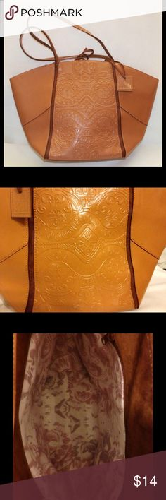 """Vintage Bora Bora Tote This large Liz Claiborne Bora Bora bag is an awesome find ! It is in new without tags condition and is unique in many ways.  It is made out of tan faux leather with brown suede trim. It has a beautiful embossed design on both sides of the bag and has the square decorative Bora Bora tag attached.  The size is 17"""" X 11"""" and is approx 4 1/2"""" wide.  The bag has two 20"""" handles and a tie closure. The inside has a pretty fabric lining with a large zippered pocket. Bora Bora…"""