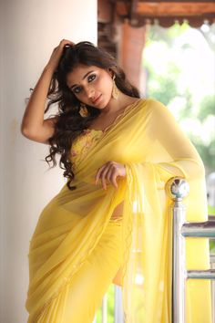 Mirnaa Menon Gorgette saree scalloped with water sequins with a statement blouse that adds bling to the attire. Styled by Jobina Vincent #mirnaa #saree #yellowsaree South Indian Actress in Saree Photograph SOUTH INDIAN ACTRESS IN SAREE PHOTOGRAPH | IN.PINTEREST.COM FASHION EDUCRATSWEB