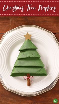 Turn a simple green napkin into a lovely Christmas decoration for your dinner table. Add a cinnamon stick to make a tree trunk, and a paper star to make a tree topper.