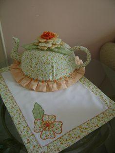 cobre bolo de tecido de algodão 100% flores em alto relevo   pode retirar para lavar  temos varias estampas de tecidos  Um lindo presente para sua cozinha