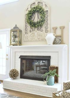 Red brick fireplace with oak surround and mantel painted white and brass fireplace screen painted with high temp spray paint. Tall ceilings with arch window wall decor above mantel. fireplace decor 7 Things You Should Do When You Decorate Your Home Red Brick Fireplaces, Fireplace Mantels, Farmhouse Wall Decor, Window Wall Decor, Fireplace Mantel Decor, Above Fireplace Decor, Brick Fireplace, Fireplace Wall, White Fireplace