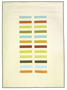 Incredibly simple quilt featuring a range of solid colors on a large negative space. $325 on etsy