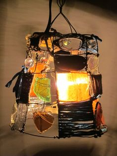 Rustic Funky Hanging Lamp...by Charest Studios on Etsy...fun idea to make a light fixture from eclectic finds!