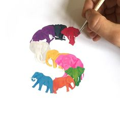 Work in progress - 9 elephants inspired by Elmer the patchwork elephant. Can't decide whether to paint the tusks gold or leave them white. Order your own animal letter @notonthehighstreet #typography #handmadefont #gouache #elephant #illustration #alphabet #letterS