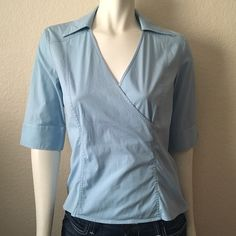 Ann Taylor Blue Wrap Blouse Ann Taylor Blue Wrap Blouse comes in baby blue cotton/spandex with a wrap top, side zipper closure-hidden in the seam and v neckline with collar. 95% Cotton 5% Spandex. Ann Taylor Tops Blouses