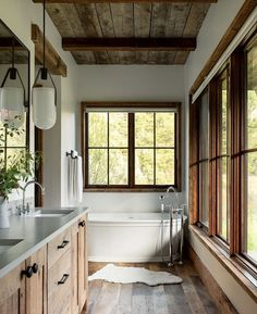 Is rustic your style when it comes to home design? Mixing metals woods and stone creates this rustic vibe in this. Cabin Bathrooms, Rustic Cabin Bathroom, Rustic Lake Houses, Rustic Bathrooms, Cabin Interiors, Cabin Homes, Beautiful Bathrooms, Home Fashion, Bathroom Interior