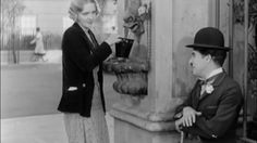 "Charlie and the blind girl in ""City Lights"" 1931."