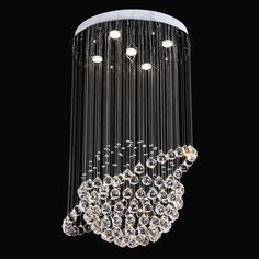 Clear crystals cascade down from a ceiling canopy creating an amazing appearance that looks like a & Clear octagonal crystal strings and glass teardrops are suspended ...