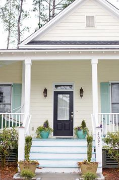 Tiffany Blue Shutters, porch, steps, and planters!