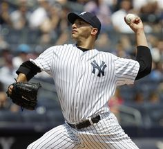 GAME 59: Sunday, June 10, 2012 - New York Yankees starting pitcher Andy Pettitte delivers in the first inning against the New York Mets during their baseball game at Yankee Stadium in New York. (AP Photo/Kathy Willens)