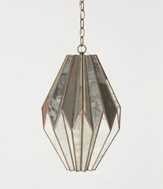 Amazing pendant lamp...looks like mirrored origami     From Anthropologie     Design*Sponge |