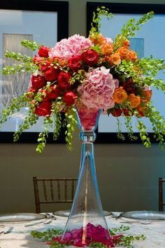 Charlotte Design - elevated centerpiece with red, pink, orange and green flowers