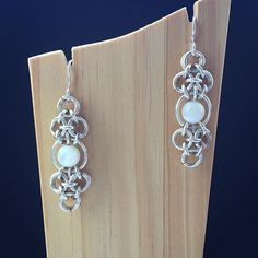 A much better photo of the Moonlight Earrings, with Mother of Pearl.  #MindarlaDesign #handcrafted #contemporaryjewellery #chainmaille #jewellery #earrings #madeinscotland #fashionjewellery #motherofpearl