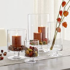 A Crate and Barrel classic, these handcrafted glass hurricanes, look as beautiful reflecting candlelight as they do filled with twinkling garlands or terrarium plantings. Diy Thanksgiving, Thanksgiving Decorations, Fall Table Decorations, House Decorations, Seasonal Decor, Crate And Barrel, Hurricane Candle Holders, Dollar Tree Candle Holders, Hurricane Glass