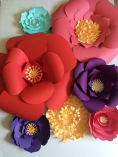 Paper Flower Wall - Bold and bright paper flowers make a big statement for any occasion. Special orders are welcome. Lots of colors to choose from too.