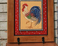 Country Rooster Hand painted towel rack on repurposed cabinet door.