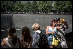 The Quiet Dignity of The Tourist at The 9/11 Memorial. #photography