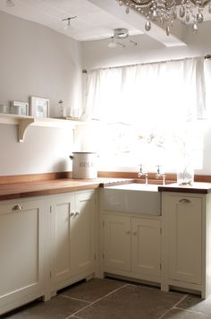 The Wymeswold Shaker Kitchen by deVOL - This beautifully simple kitchen is part of a restoration project in a country manor house. The choice of a butchers block adds an authentic freestanding feel to the kitchen, with Umbrian Limestone flooring giving a Devol Kitchens, Shaker Style Kitchens, Home Kitchens, Rustic Kitchens, Cottage Kitchens, Farmhouse Kitchen Curtains, Farmhouse Kitchen Cabinets, Farmhouse Chandelier, Kitchen Chandelier