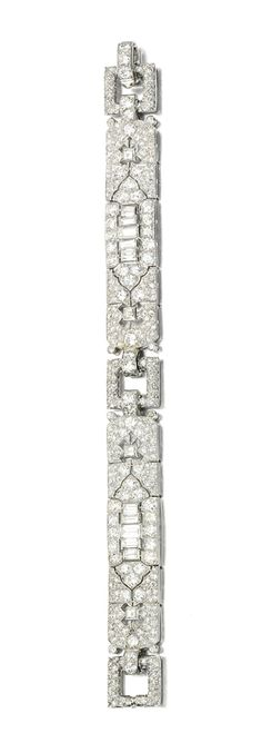 Diamond bracelet, Cartier, circa 1925 - Sotheby's.  The pierced geometric plaques set with circular-cut, square and baguette diamonds, length approximately 172mm, signed Cartier and numbered, later case stamped Cartier.