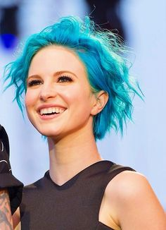 Halyey Williams of Paramore, featuring a bright, sky blue pixie cut.