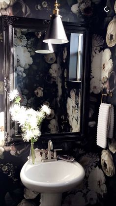 Gorgeous floral wallpaper in @stephaniewatts powder room