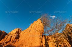View Inside Small Desert Canyon ...  arid, blue, cactus, clouds, colombia, desert, desolate, drought, dry, environment, evening, golden, heat, horizon, hot, huila, land, landscape, light, natural, nature, outdoor, outdoors, parch, pillar, red, rock, sand, scenery, scenic, sky, stone, summer, sun, sunlight, sunny, tatacoa, tourism, travel, tree, valley, view, waterless, weathered, wild, wilderness