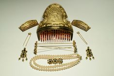 The women's costume from Valencia, Spain is supplemented by matching jewelry: hair combs and pins, earrings, bodice pin and pearl necklace.