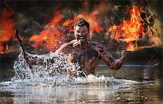 A White young attractive man as a warrior fighting in water with explosion and flames behind him well build like the gladiators