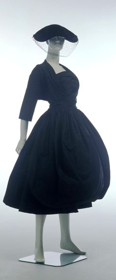 """Evening Dress and Jacket, Cristóbal Balenciaga (Paris, France): 1954, silk. """"This silk evening dress and jacket was designed and made by the Spanish born couturier Cristobal Balenciaga in Paris, France in 1954 and was owned and worn by Phyllis Kendall, Sydney socialite and charity worker. The dress demonstrates Balenciaga's skill in sculpting fabric through its elegant and harmonious proportions and balloon silhouette."""""""