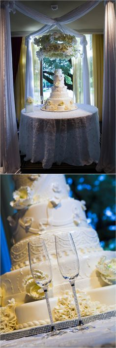 Six tiered white wedding cake accented with flowers ~ Photo: John Ly Photography