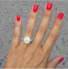 This is the ring I would love to be proposed with!! Round, halo, perfection.